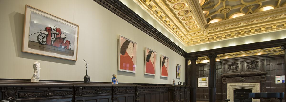 Photograph of Music Room with artwork on the walls