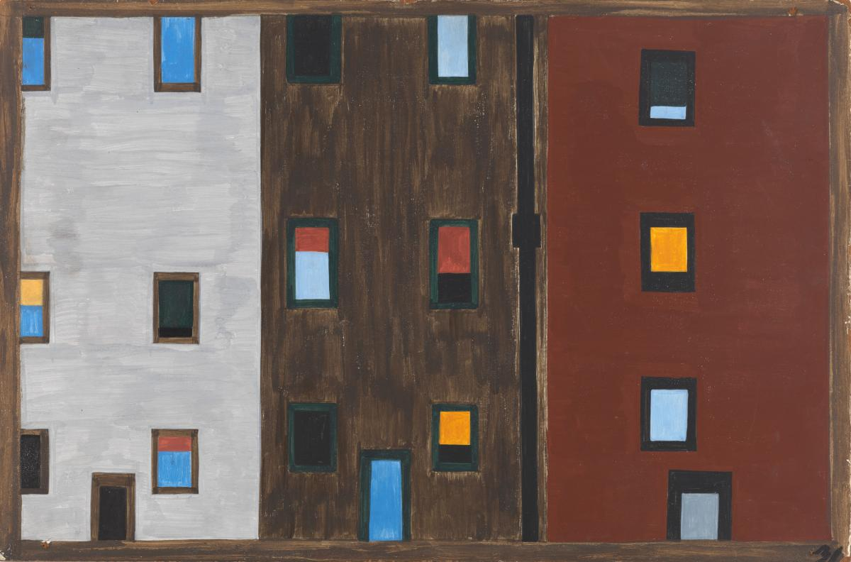Three high rise apartments, one grey, one dark brown and one rust colored with many colors of windows.