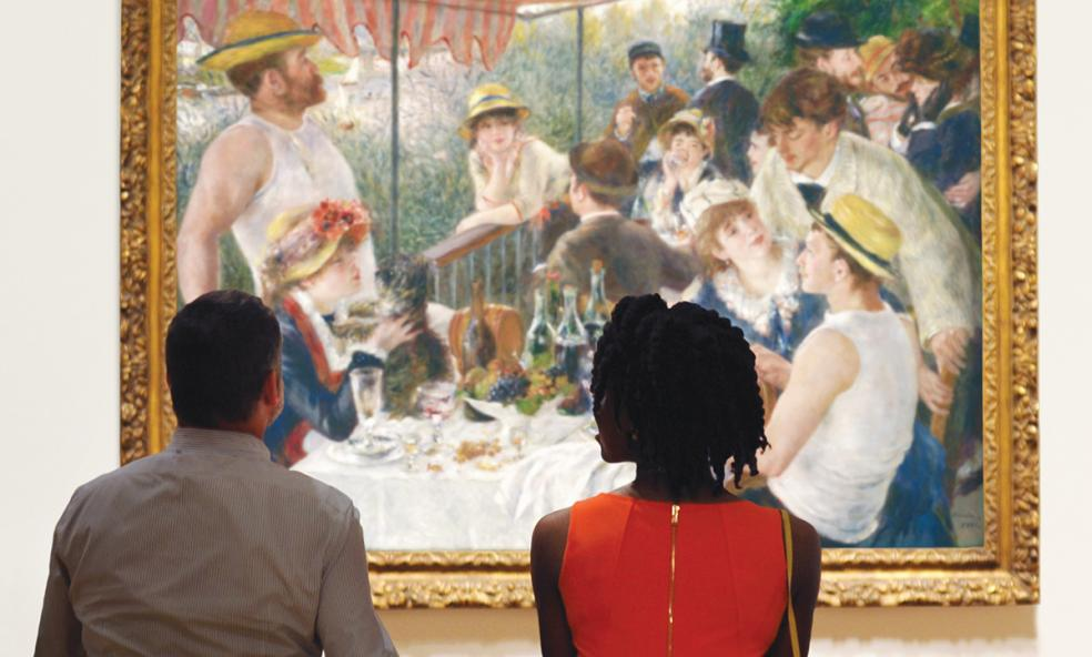 Two people sitting on a bench looking at Renoir's Luncheon of the Boating Party