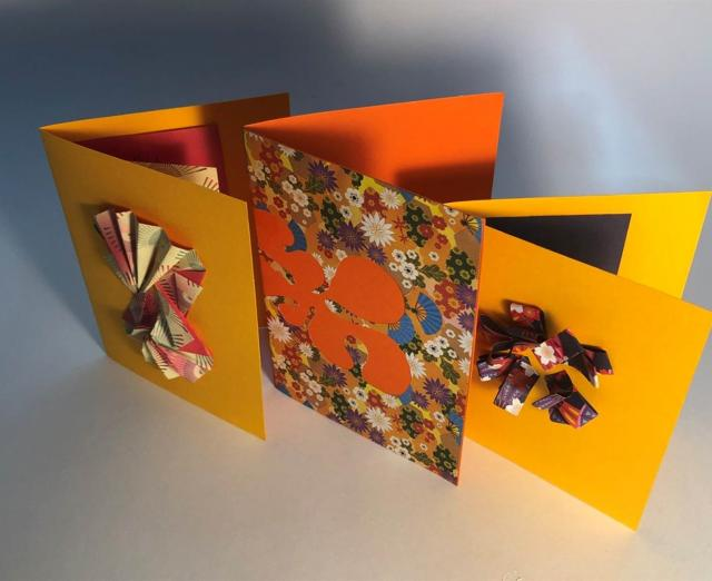 Photograph of orange and yellow paper cards
