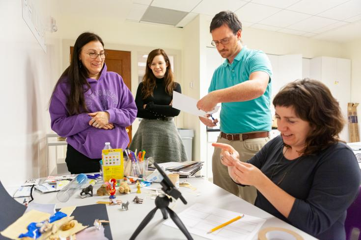 Four educators learning how to use stop-motion animation in the Phillips's art workshop