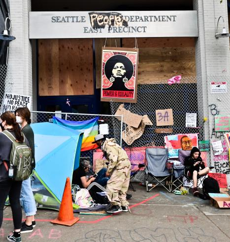 Photograph of people camped out by the Seattle Police Department