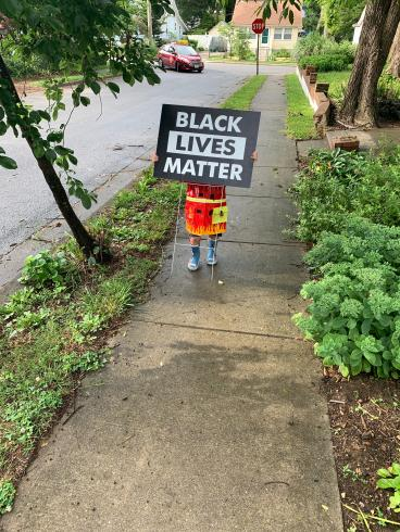 "Photograph of a small child holding a ""Black Lives Matter"" sign"
