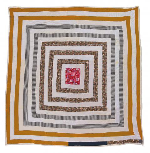 A square quilt made with concentric yellow and white squares with a pink square in the middle